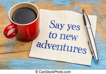 Say yes to new adventures - handwriting on a napkin with a...
