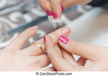 the girl suffered a cut finger on the manicure. inattentive...