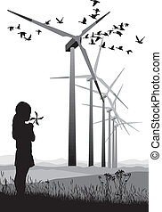 A small girl and Wind Turbine - A small propeller and large...