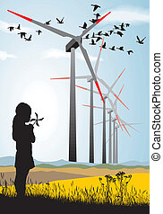 Girl and Wind turbine - A small propeller and large wind...