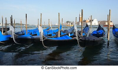 Gondolas in Venice - Vacation in romantic Venice at sunny...