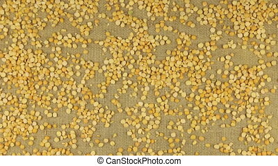 Approximation of dried peas grains scattered on burlap, top...