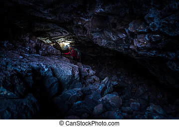 Woman Exploring Dewdrop Cave Craters of the moon National...