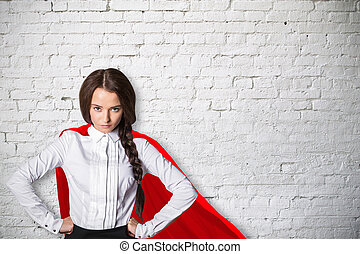 Power concept - Confident caucasian superwoman with red cape...