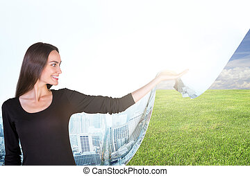 Eco and nature concept - Smiling young woman dragging...