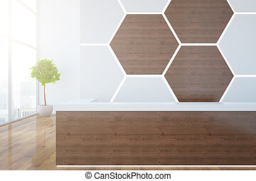 Wooden reception desk with honeycomb pattern on wall,...