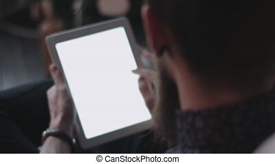 Hipster using digital tablet at New Year's Eve. - Hipster...
