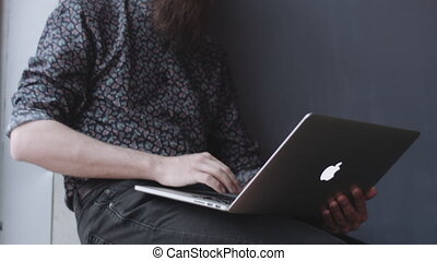 Hipster using digital notebook. - Hipster with beard and...