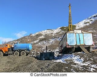 Equipment in place of gold exploration. Caravan with a tower...