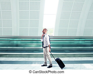 Businessman traveling for work - Businessman walking with...