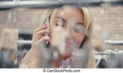 Beautiful girl talking on the phone and smiling. Blonde girl...