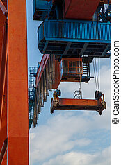 Seaport crane and container with blue cloudly sky