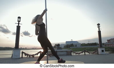 Street Pole dance on sunset stock footage video - Street...