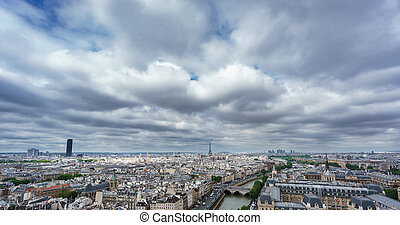 Eiffel and Montparnasse towers over Paris, cloudy day -...