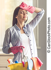Woman cleaning her house - Beautiful woman in protective...