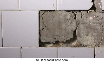DOLLY: Cracked ceramic tiles falling off from the wall in bathroom or kitchen