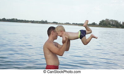Dad with baby swimming