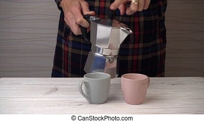 woman pouring coffee from a geyser coffee maker - woman...