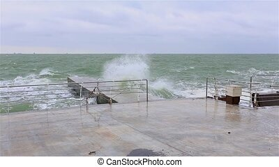 waves crashing at the breakwater at the stormy day