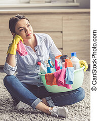 Woman cleaning her house - Beautiful tired woman in...