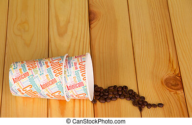 Disposable paper cups and coffee beans on background light...