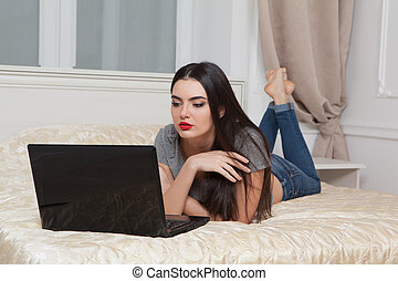 Girl with a computer at home.