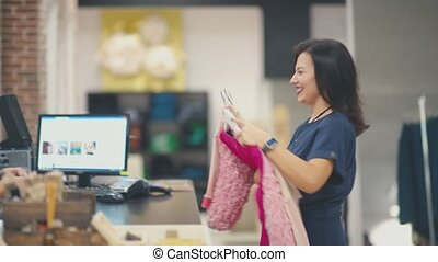 Customer service in the store and pretty customer. Shopping girl