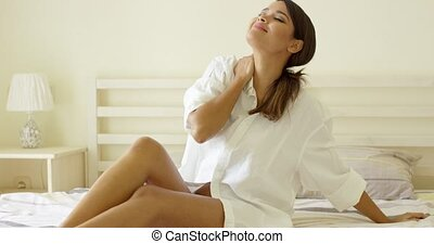 Sensual young woman stretching on her bed - Sensual young...