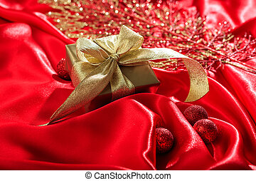 Gift box on a red satin background