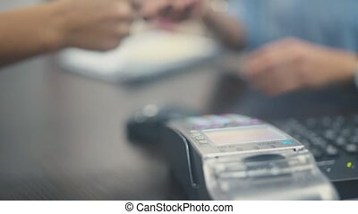 Close Up: Credit card payment terminal. Transfer payment....