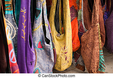Display of multicolored purses at a public market
