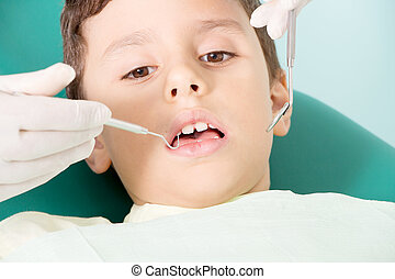 Little kid smiling at dental clinic