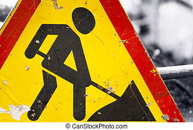 Under construction sign - A close-up photo of a road sign...