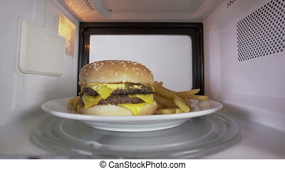 Reheating a double cheeseburger with french fries in the microwave