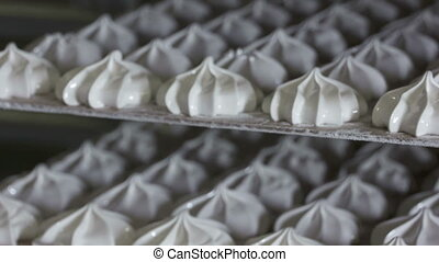 Rows of finished marshmallow zephyr at confectionery...