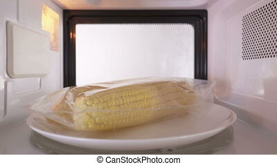 Cooking fresh shucked corn in plastic ziplock bag in the...