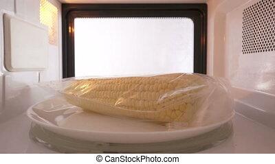 Cooking fresh shucked corn in plastic ziplock bag in the...