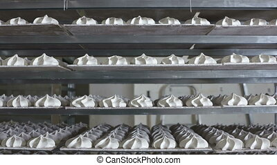 Cooling racks with finished marshmallow zephyr on trays at...