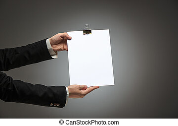 Male hands holding empty blank page - Male hands holding...