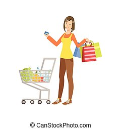 Woman With Shopping Bags And Full Cart Holding Credit Card