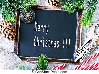 christmas background - black board and candy canes on a...