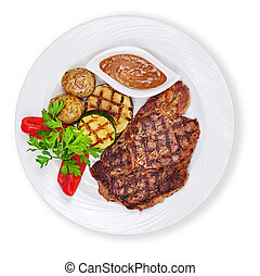 Grilled steak, potatoes and vegetables isolated on white backgro