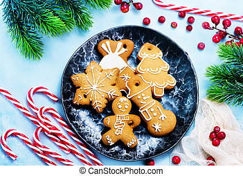 christmas background - cookies and candycane on a table,...