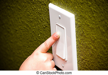 Little girl turning on decor lightswitch