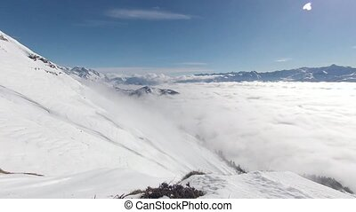 Mountains above Time Lapse Clouds - Winter snowy Mountains...