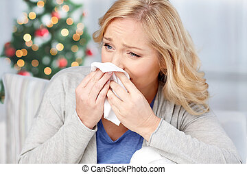 ill woman blowing nose to paper napkin - healthcare, flu,...