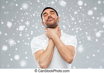 young man choking himself over snow background