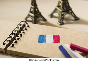 French flag drawing on the sketchbook and Eiffel tower