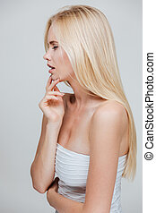 Side view of an attractive blonde woman with long hair...