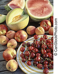 variety of fruits on a table in the garden